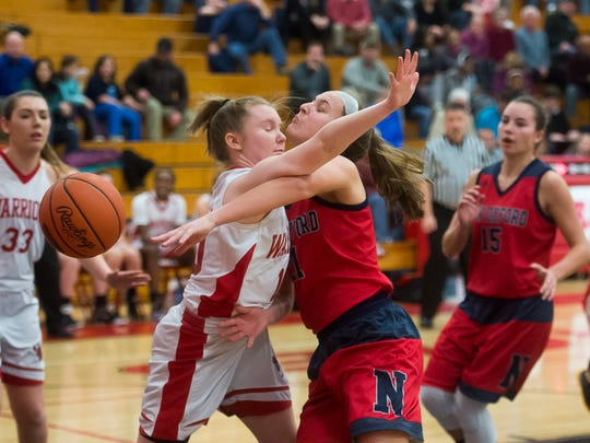New Oxford's Kaelyn Long collides with Susquehannock's Maggie Sisler during play on Friday, Feb. 10, 2017. New Oxford defeated Susquehannock 54-40.