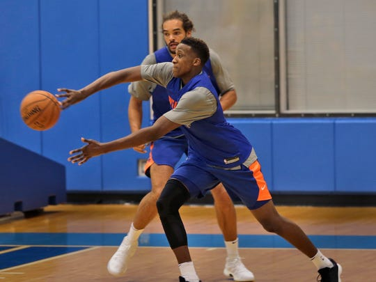 Knicks' Frank Ntilikina, front, passes in front of Joakim Noah during NBA basketball practice in Greenburgh, N.Y., Tuesday, Sept. 26, 2017.