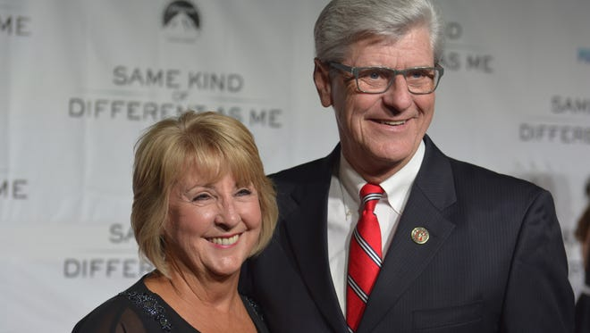 """This file photo shows Gov. Phil Bryant and First Lady Deborah Bryant attending an advance screening of the motion picture """"Same Kind of Different As Me."""""""