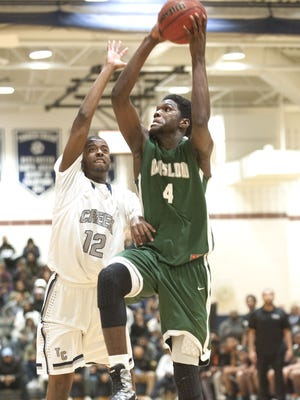 Winslow Township senior forward Manny Lowe goes up for a shot over Dylan Johnson of Timber Creek during last week's South Jersey Group 3 semifinal.