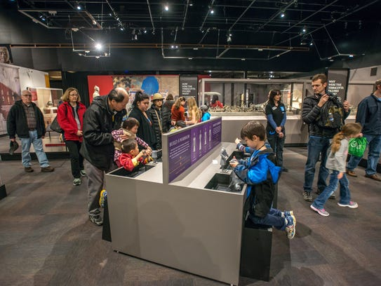Children attempt to recreate warriors at the new exhibition