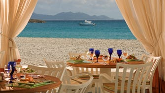 Fronting Maundays Bay, the resort impresses with details like terraces that welcome the gentle wind through louvered plantation shutters and sorbet served on the beach every afternoon.
