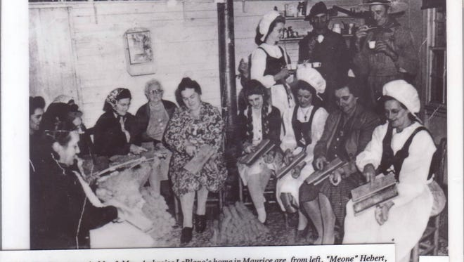 """Working women  In 1945, a host of folks gathered at Mr. and Mrs. Ambroise LeBlanc's home in Maurice for a session of cording cotton and included """"Meone"""" Hebert, Mrs. LeBlanc, Lorita Racca, Gladys Clark, Mrs. Willie Racca, Mrs. Ambroise LeBlanc. Standing are Eve LeBlanc, Mr. Hebert and Ambroise LeBlanc."""