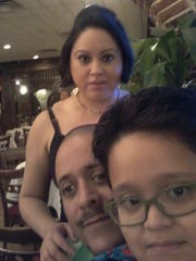 Iris Castenada with her husband and son.