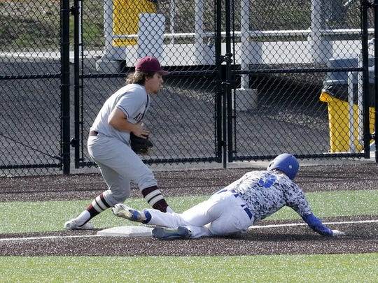 Mike Limoncelli of Horseheads slides into third base as Arlington's Jon Iula fields the throw during a Class AA regional at Maine-Endwell on Thursday.