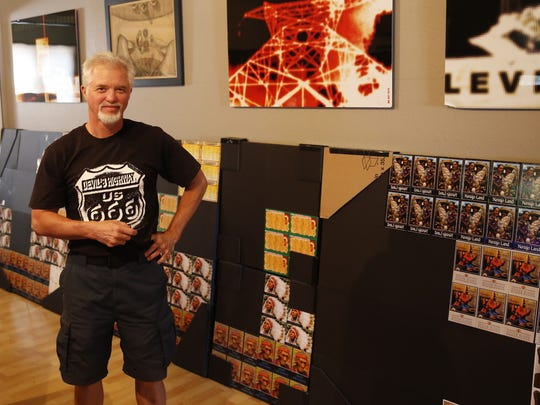 Michael Darmody shows off some of his work in the living room of his Farmington home on Wednesday.