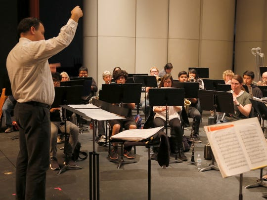 Conductor Teun Fetz leads the San Juan College Symphonic Band through a warmup before Thursday night's rehearsal.