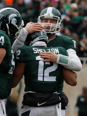 Michigan State quarterback Connor Cook, right, and receiver R.J. Shelton (12) celebrate Shelton's touchdown reception against Rutgers.