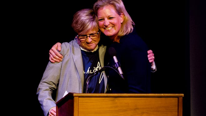 """Lady Vols head coach Holly Warlick and former Lady Vol Michelle Brooke-Marciniak hug at the """"Pat - A Legacy of Love"""" movie premiere event at the Bijou Theatre in Knoxville, Tennessee on Thursday, September 7, 2017. The documentary movie focuses on Pat Summitt's work in bringing basketball to young girls in Iraq."""