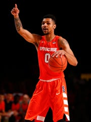 Syracuse forward Michael Gbinije (0).