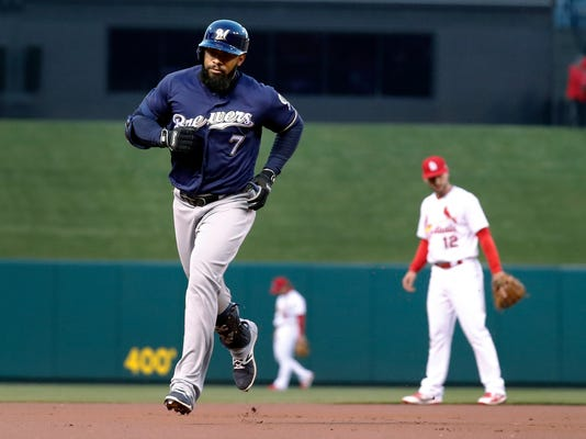 Milwaukee Brewers' Eric Thames rounds the bases after hitting a solo home run during the first inning of a baseball game against the St. Louis Cardinals on Tuesday, April 10, 2018, in St. Louis. (AP Photo/Jeff Roberson)