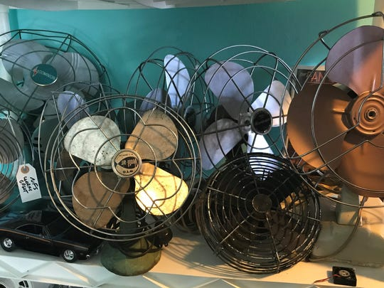 Fan collectors love vintage fans because of the quality of craftsmanship, said 13-year-old fan collector Reece Umbreit of North Fond du Lac. These old desk fans occupy a shelf in his room.