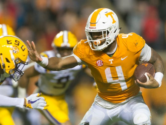 Tennessee running back John Kelly (4) pushes away an