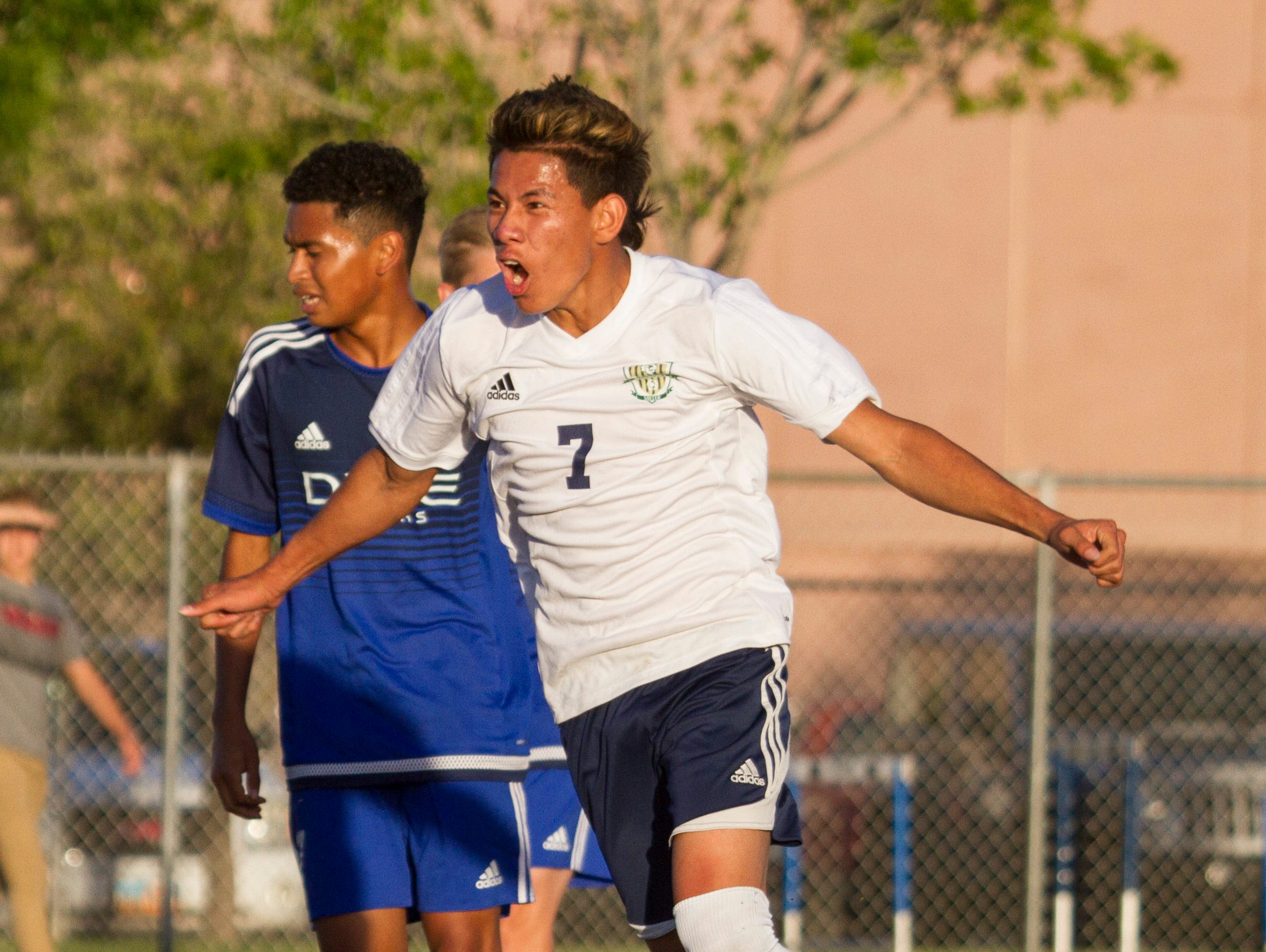 Snow Canyon's Kevin Guevara celebrates scoring the opening goal against Dixie. Tuesday, April 12, 2016.
