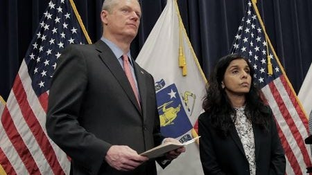 Gov. Charlie Baker and Public Health Commissioner Monoca Bharel speak during a press conference in June. The Supreme Judicial Court is hearing arguments that Baker lacked the authority to issue executive orders during the pandemic.
