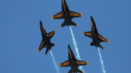 Diamond pilots assigned to the U.S. Navy flight demonstration squadron, the Blue Angels, perform the barrel role break maneuver during the Fort Worth Air Power Expo at Naval Air Station Joint Reserve Base Fort Worth.