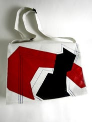 Pictured here is the Dome Project Messenger Bag made