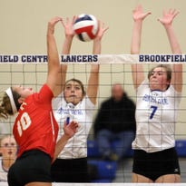 Divine Savior Holy Angels' Emily Ament (10) attempts to hit past Brookfield Central's Marissa Zepecki (left) and Abby Wucherer (7) during the teams W.I.A.A. Sectional Semi-Final match in Brookfield Central High School Thursday, Oct. 27, in Brookfield, Wisconsin.