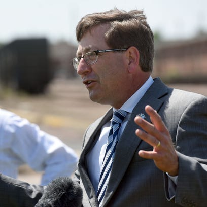 Mayor Mike Huether speaks June 8 during a news conference along Sixth Street in downtown Sioux Falls.