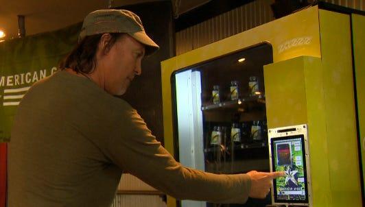 Stephen Shearin, chief operating officer for Tranzbyte, demonstrates how the ZaZZZ marijuana vending machine will operate.