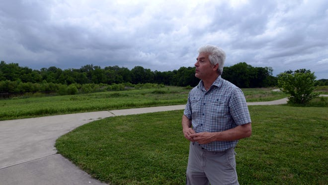 David Hague stands near a wetland at Coyote Run Farm in Violet Township. Hague and his significant other Tammy Miller have spent the last 10 years reclaiming and preserving hundreds of acres in Violet Township.