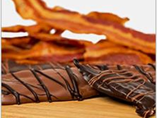 Strips of hickory-smoked bacon is coverd in dark or milk chocolate from from Cocoa Beau, featuring David Bradley Chocolate.
