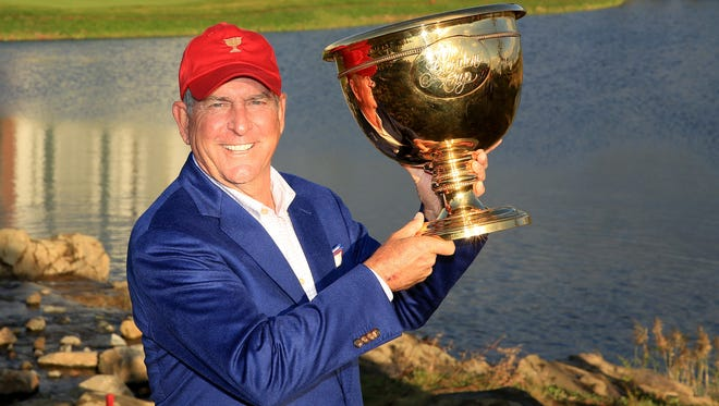 Jay Haas, the U.S. team captain, poses with the Presidents Cup after his team had won the match on Sunday.