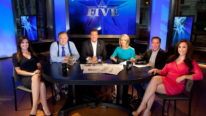"This July 1, 2013 photo shows, from left, Kimberly Guilfoyle, Bob Beckel, Eric Bolling, Dana Perino, Greg Gutfeld and Andrea Tantaros co-hosts of Fox News Channel's ""The Five""  following a taping of the show in New York. The program's deceptively simple premise is five folks sitting around a table at 5 p.m. EDT, kicking around the day's news and hot topics. This year ""The Five"" has emerged as Fox's second most popular show, behind only Bill O'Reilly, despite not having the larger pool of potential viewers that prime time usually provides."