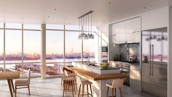Interior spaces at One Park in Cliffside Park feature expansive kitchens with chef-caliber appliances, fine fixtures and impressive views.