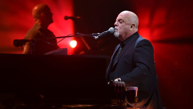 Musician Billy Joel performs during his 100th lifetime performance at Madison Square Garden on Wednesday, July 18, 2018, in New York. (Photo by Evan Agostini/Invision/AP)