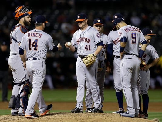 Houston Astros pitcher Brad Peacock (41) hands the ball to manager A.J. Hinch (14) as he is relieved in the sixth inning of a baseball game against the Oakland Athletics, Monday, June 19, 2017, in Oakland, Calif. (AP Photo/Ben Margot)