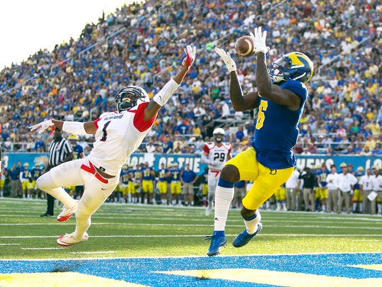 Delaware receiver Jamie Jarmon snags a touchdown reception over Richmond defensive back Jarriel Jordan in the second quarter at Delaware Stadium in the Blue Hens' overtime win.