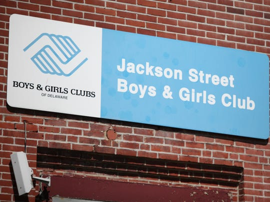 A broken security camera hangs underneath the entrance of the old Jackson St. Boys & Girls Club.