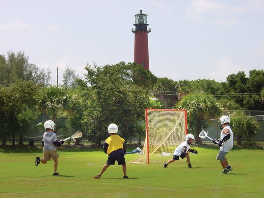Some enthusiastic kids play lacrosse at Lighthouse Park in Jupiter recently, as part of a town of Jupiter Recreation Department program.