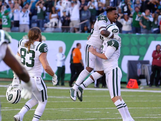 New York Jets kicker Chandler Catanzaro celebrates with New York Jets safety Jamal Adams  after kicking the game winning field goal against the Jacksonville Jaguars during overtime at MetLife Stadium.