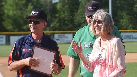 Mickey, left, and Linda Huskey react as a banner is unveiled naming the press box at Lester White Field in their honor on May 31, 2014. Mickey Huskey passed away Tuesday while on vacation in Oklahoma.