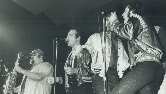 Lennie Baker, left, performs with Sha Na Na in 1973.