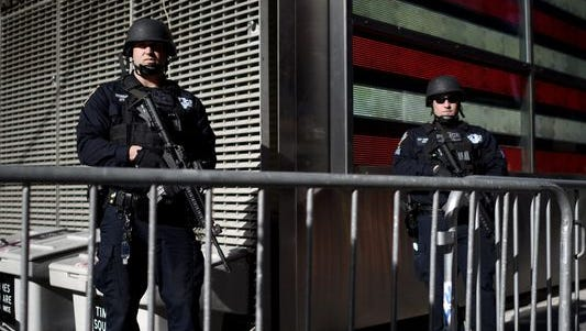 New York City police on patrol in Times Square following the Nov. 13, 2015 terror attacks in Paris. Officials said some 7,000 police officers will be out in force for this year's New Year's Eve celebration.