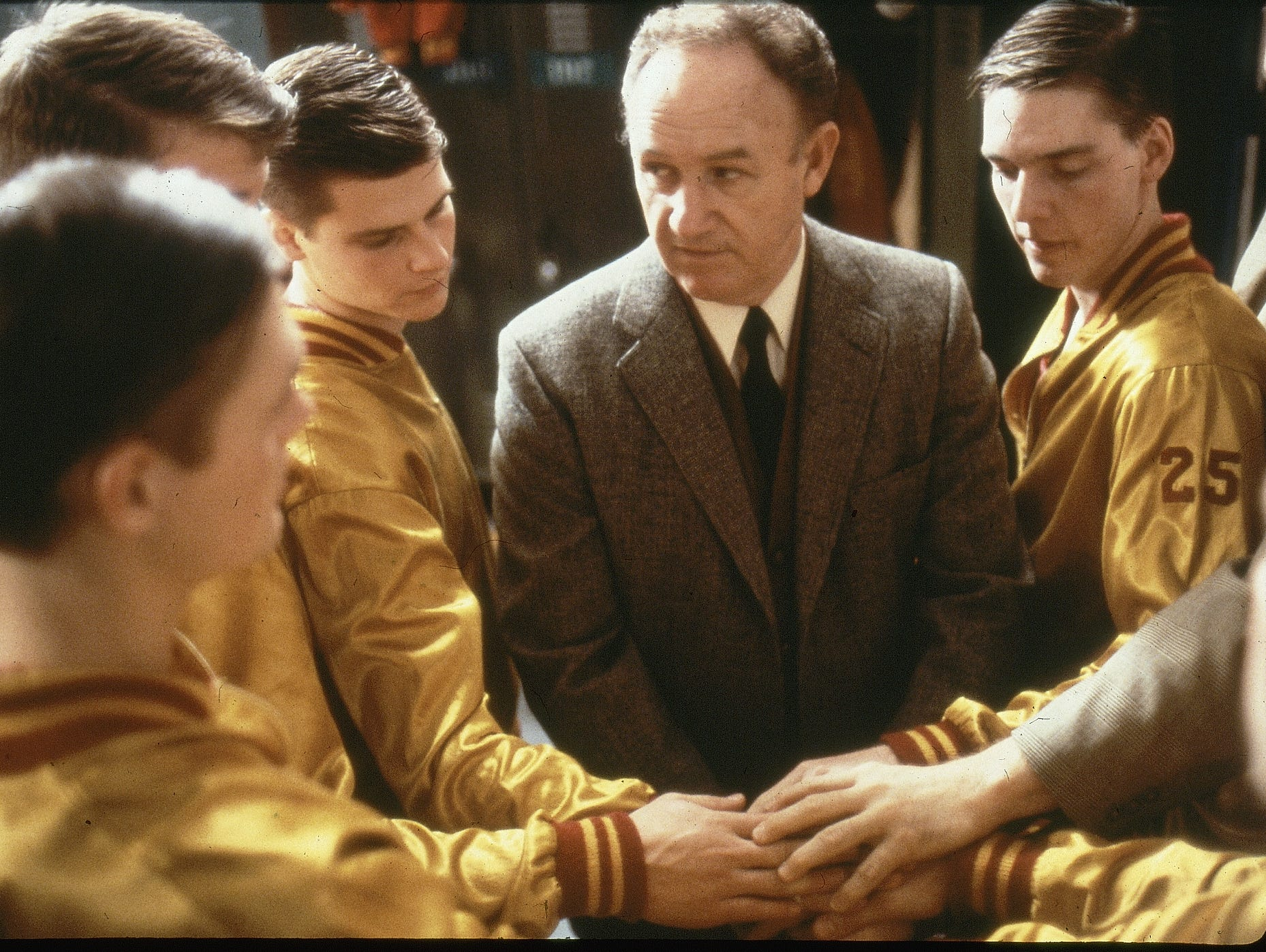 "Actor Gene Hackman, as coach Norman Dale, prepares to send players out onto the court in the 1986 movie ""Hoosiers."""