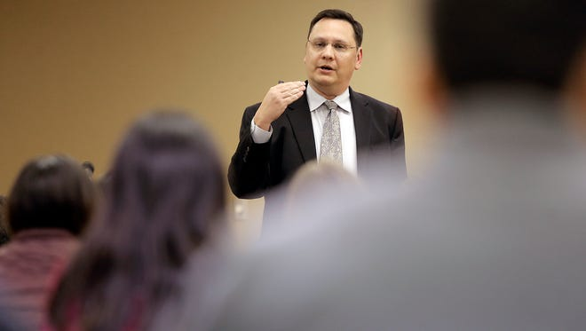 UTEP Vice President for Student Affairs Gary Edens talks to students about a possible tuition increase during a forum Wednesday at the Student Union.