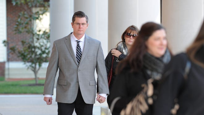Dover Police officer Cpl. Thomas Webster, with his wife Suzanne walk to the Kent County Courthouse on Friday morning for closing arguments in the second-degree assault trial against Webster.