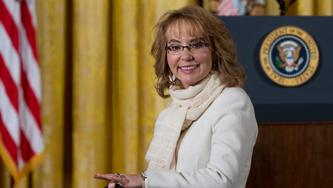 Former Arizona Rep. Gabrielle Giffords arrives in the East Room of the White House in Washington in January prior to President Obama's announcement of a more sweeping definition of gun dealers.