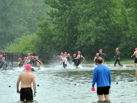 A flight of triathletes take to the water at the Hawk Island Spring Triathlon Sunday, June 5, 2016. The event had to be cancelled later due to lightning.