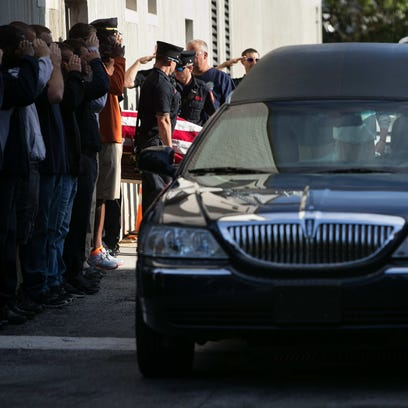 The casket of Senior Firefighter Jerry Fickes is carried
