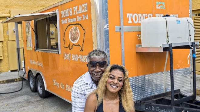 Belinda Wright and Larry Thomas, food truck runner, with their truck at Tom's Place at the Boynton Beach Mall in November 2019.