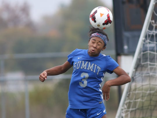 Summit's Ravin Alexander heads the ball during their  1-0 win over Madeira, Saturday, Nov. 4, 2017.