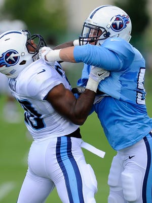 Titans running back Bishop Sankey, left, tries to stop linebacker Colin McCarthy during pass-rush drills at Saint Thomas Sports Park on Monday.