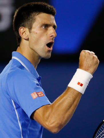 Novak Djokovic of Serbia reacts against Milos Raonic