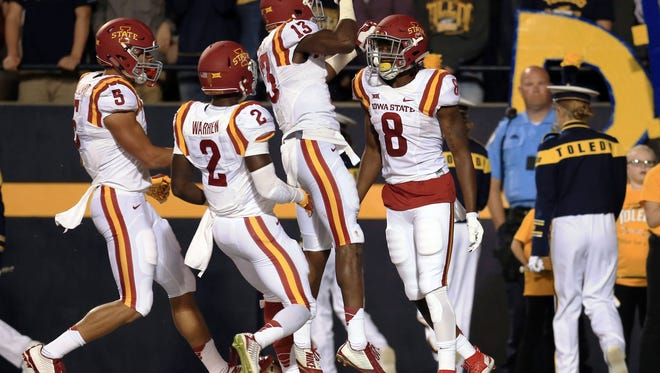 Iowa State Cyclones wide receiver D'Vario Montgomery (8) celebrates with teammates after scoring a touchdown during the second quarter against the Toledo Rockets at Glass Bowl.