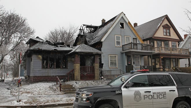 Fire destroyed one house on the 3200 block of N. 21st St. and damaged another Thursday, Dec. 28, 2017. It was one of several fires Milwaukee firefighters battled on the cold day.